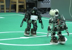 Programming robots to play football